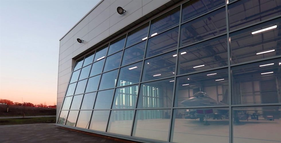 europe british aerospace hydroswing hydraulic door with custom glass cladding
