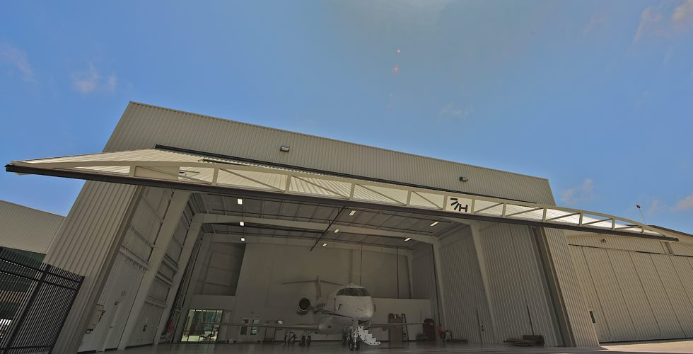 hydroswing uk europe tall hydraulic aviation hangar door private jet